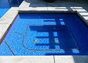 Cathedral City spa remodel, dark two color crystal tile mix