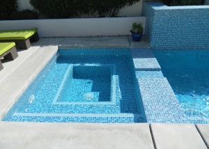 Palm Springs spa remodel, Painted crystal tile, light blue 2 line accent